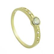 Zlatý prsten s bílými zirkony po stranách šíny a uprostřed jeden velký 010.00116